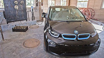 A photo of an electric BMW plugged in at the new charging station at Thomas Edison National Historical Park.