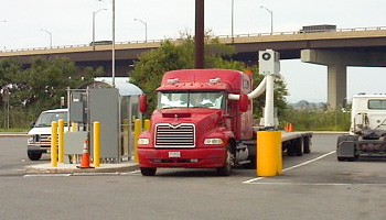 An 18-wheeler stationed at a truck stop.