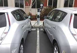 Photo of two electric cars charging