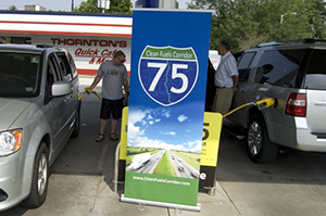 This photo shows two drivers fueling their vehicles with E85 along the I-75 Clean Fuels Corridor.