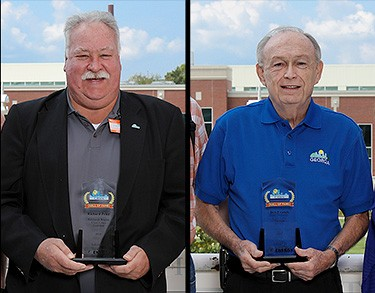 A photo of the Clean Cities Hall of Fame winners posing with their awards on an outdoor balcony.